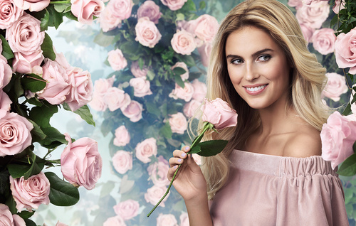 Smiling beautiful woman with different flowers background Stock Photo 05