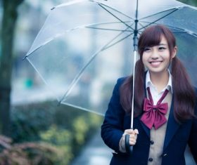 Smiling girl hold up an umbrella Stock Photo