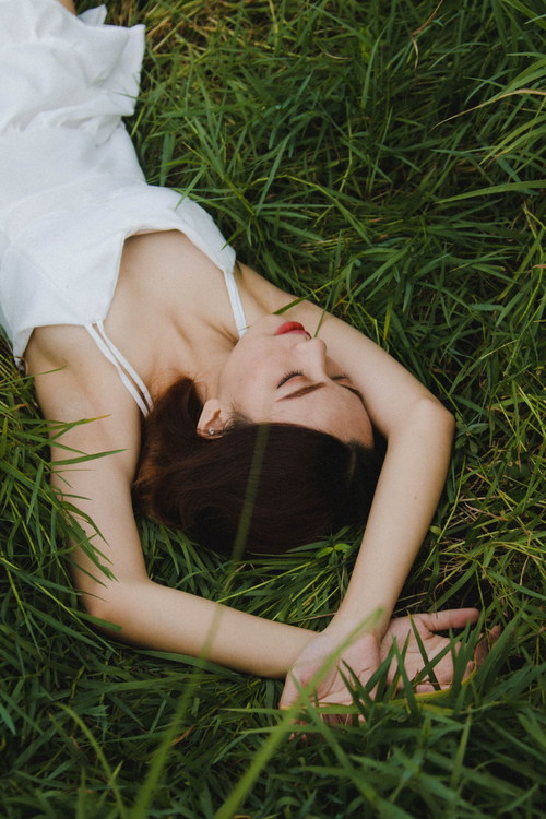 Stock Photo Girl lying on the grass