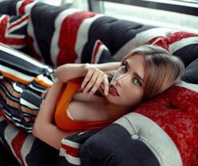 Stock Photo Girl lying on the sofa