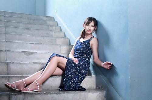 Stock Photo Girl sitting on the corridor