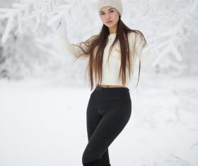 Stock Photo Girl taking pictures in the snow