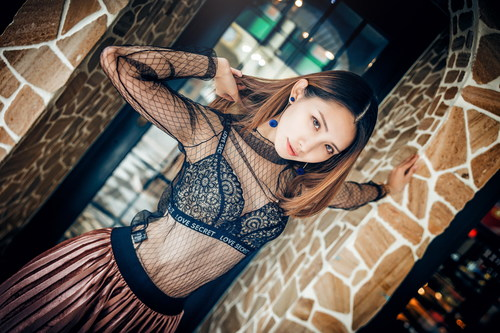 Stock Photo Girl wearing a beautiful black blouse