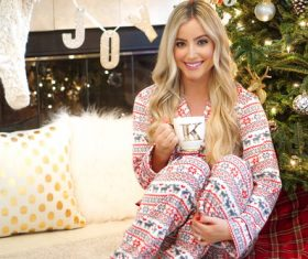 Stock Photo Girl wearing pajamas drinking coffee