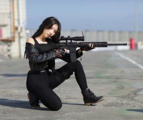 Stock Photo Girl who likes gun