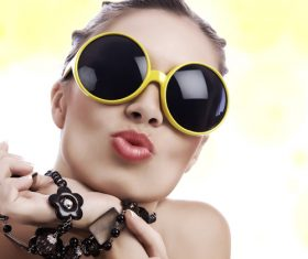 Stock Photo Girl with sunglasses pursed lips