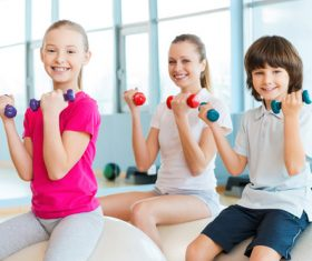 Stock Photo Happy child photography holding a dumbbell