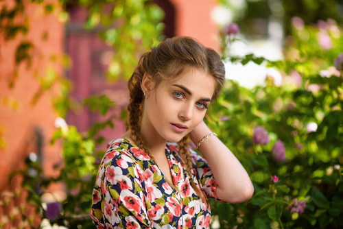 Stock Photo Pretty girl with flower background