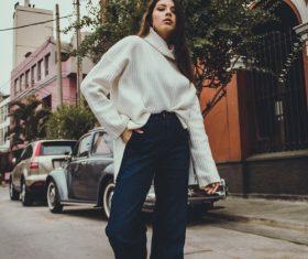 Street beat sweater jeans beauty Stock Photo
