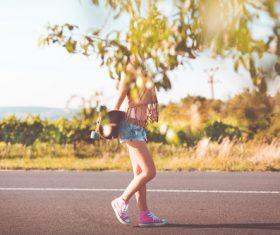 Summer Ride Longboard Girl Stock Photo