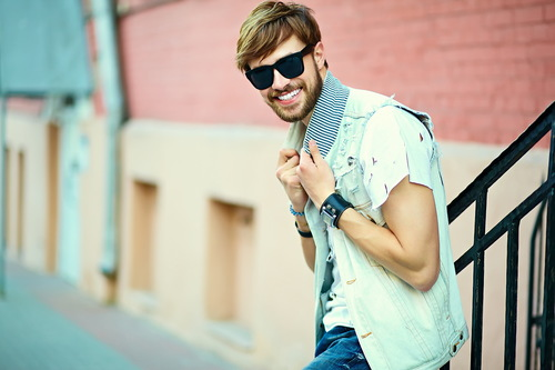 Sunglasses man leaning against stair railing Stock Photo