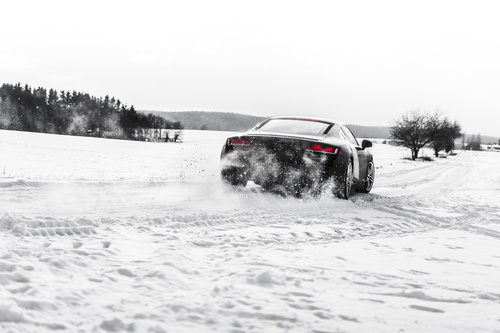 Supercar Drifting on a Snow Covered Road Stock Photo