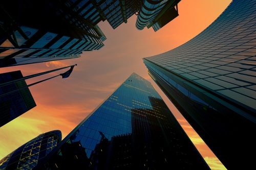 Wide angle lens of skyscraper under sunset Stock Photo