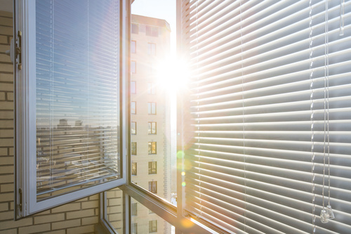 Window with sand coloured roll sun blinds Stock Photo 02