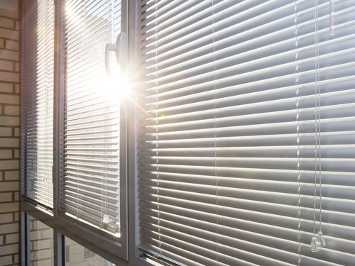 Window with sand coloured roll sun blinds Stock Photo 03