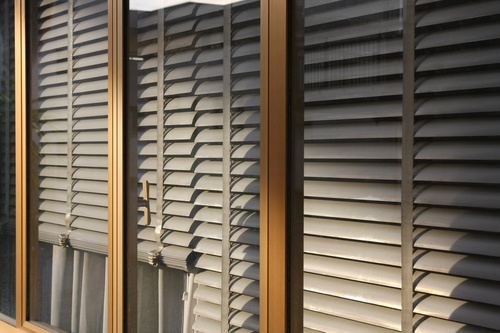Window with sand coloured roll sun blinds Stock Photo 05