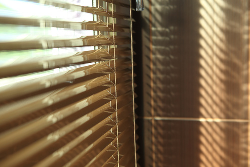 Window with sand coloured roll sun blinds Stock Photo 07