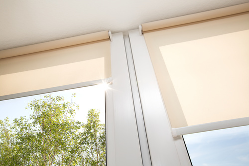 Window with sand coloured roll sun blinds Stock Photo 09