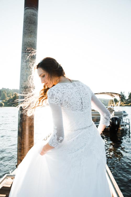 Woman photographing wedding photos by the sea Stock Photo