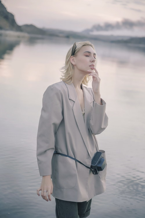 Woman posing by the lake Stock Photo