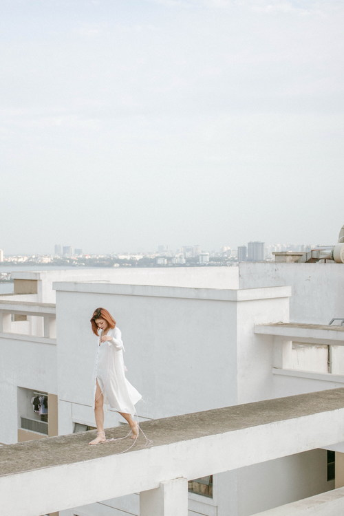 Woman walking on the roof Stock Photo
