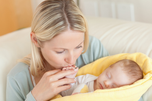 Young mother holding her sleeping baby Stock Photo 05