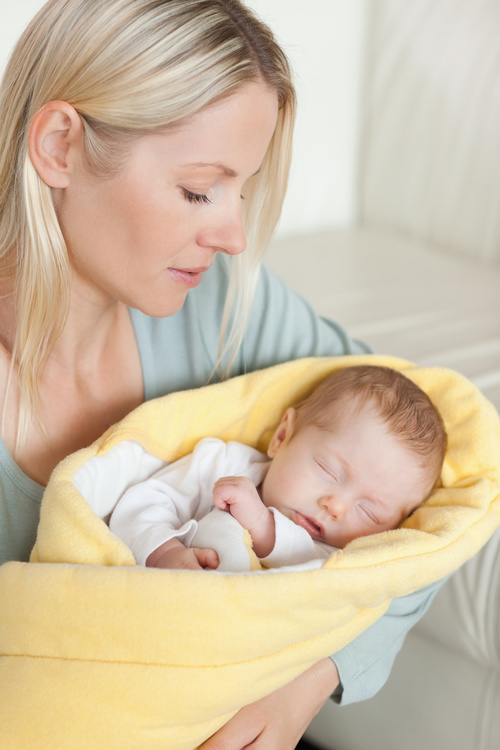 Young mother holding her sleeping baby Stock Photo 08