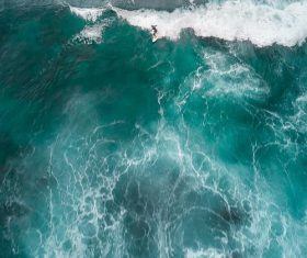 Aerial view of the waves rolling up on the sea Stock Photo