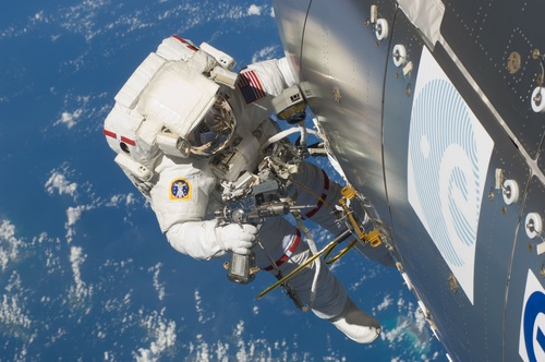 Astronaut walking maintenance in space Stock Photo 03