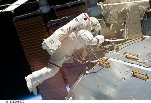 Astronaut walking maintenance in space Stock Photo 04