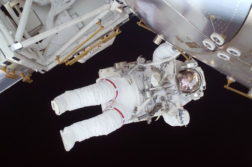 Astronaut walking maintenance in space Stock Photo 07