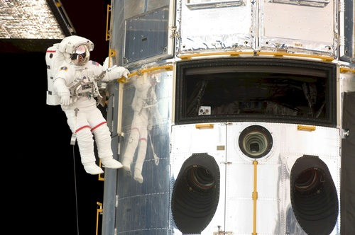 Astronaut walking maintenance in space Stock Photo 11