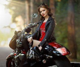 Beautiful female motorcyclist Stock Photo
