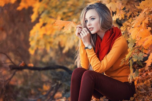 Beautiful girl and autumn maple Stock Photo