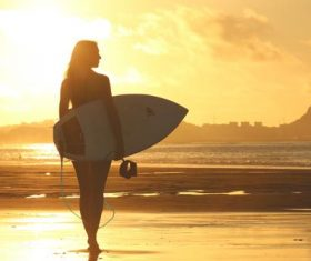 Beautiful woman holding a surfboard Stock Photo