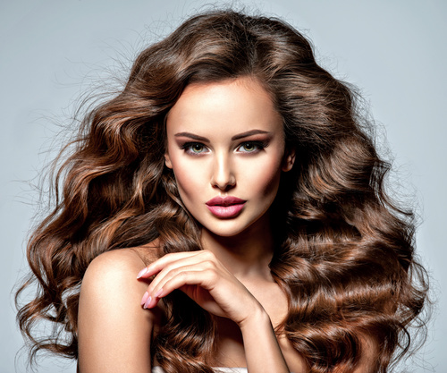 Beautiful woman with long brown curly hair Stock Photo 02