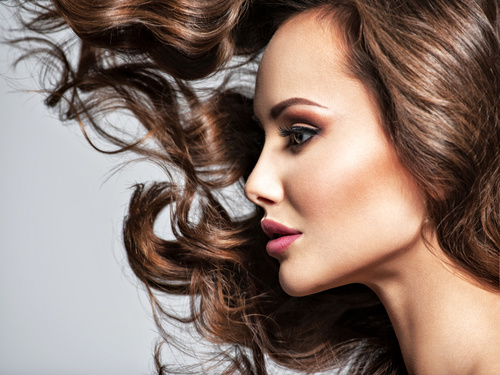 Beautiful woman with long brown curly hair Stock Photo 04
