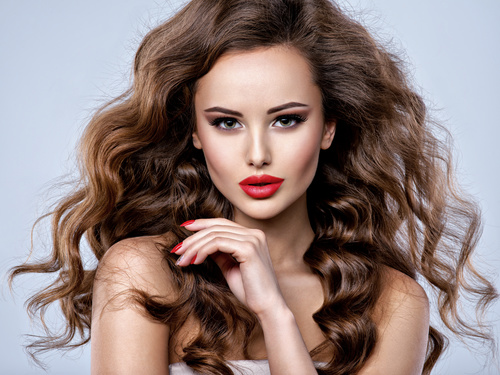 Beautiful woman with long brown curly hair Stock Photo 05