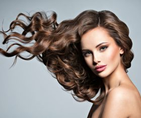 Beautiful woman with long brown curly hair Stock Photo 06