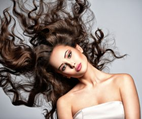 Beautiful woman with long brown curly hair Stock Photo 07