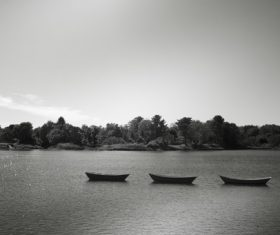 Black and white photo Canoes Floating on Lake Stock Photo