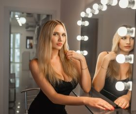 Blonde sitting in front of the mirror Stock Photo