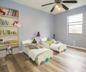 Bookshelves and cots in childrens rooms Stock Photo