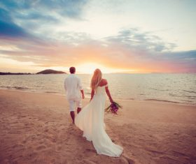 Bride groom walking by the sea Stock Photo