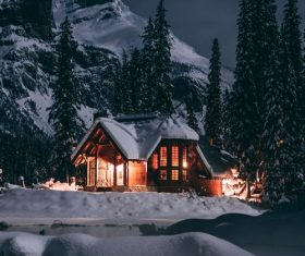 Brightly lit houses on winter night Stock Photo