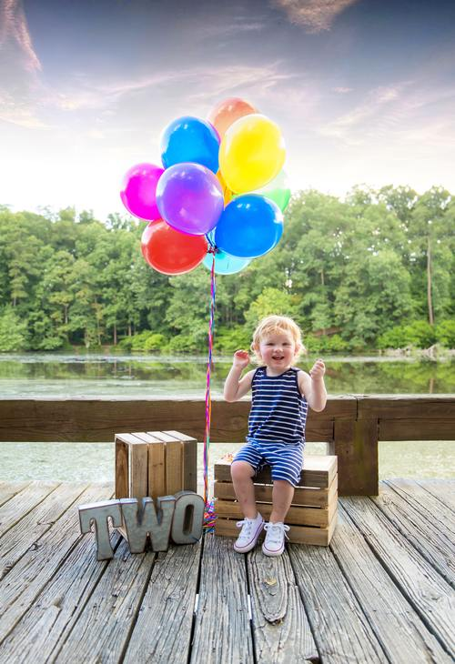 Child who see balloons happy Stock Photo