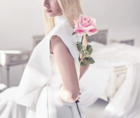 Elegant young blonde holding a beautiful pink rose Stock Photo 01