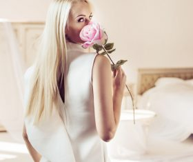 Elegant young blonde holding a beautiful pink rose Stock Photo 03