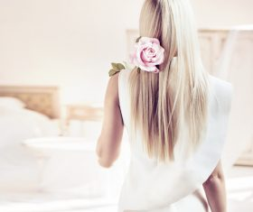 Elegant young blonde holding a beautiful pink rose Stock Photo 04