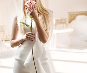 Elegant young blonde holding a beautiful pink rose Stock Photo 05